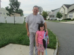 Daddy and Madi at the bus stop on the first day